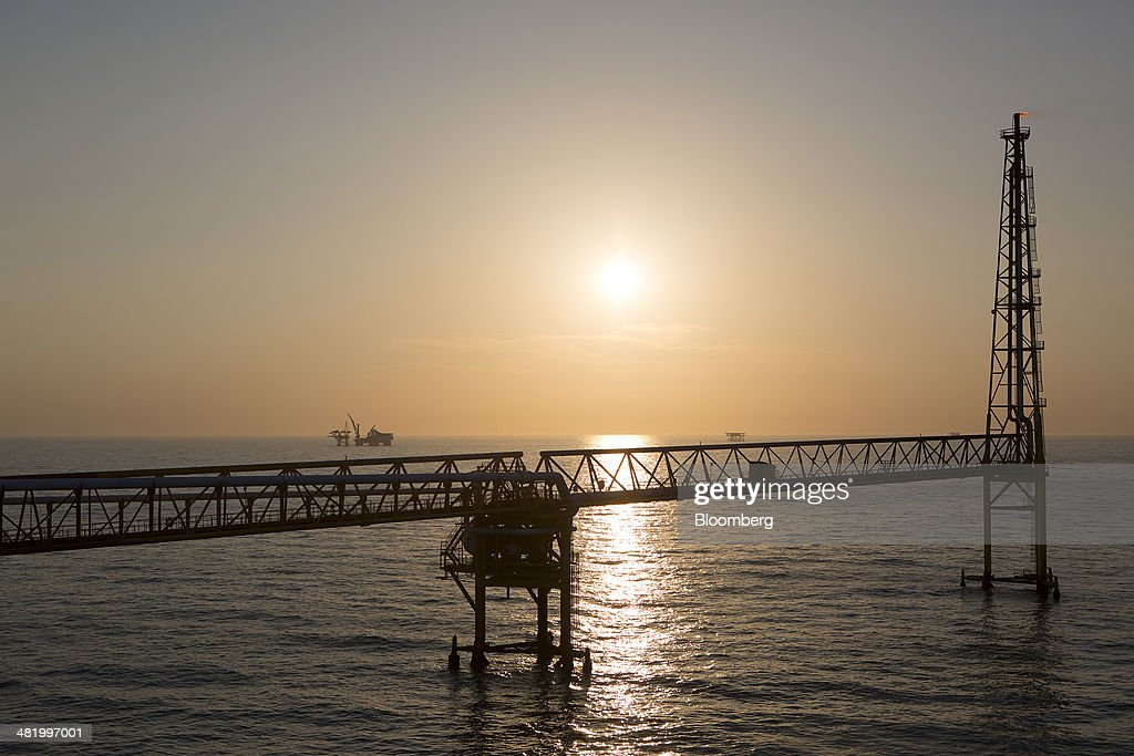 The sun sets over a connecting bridge at the Petroleos Mexicanos PolA Platform complex located on the continental shelf in the Gulf of Mexico 70...