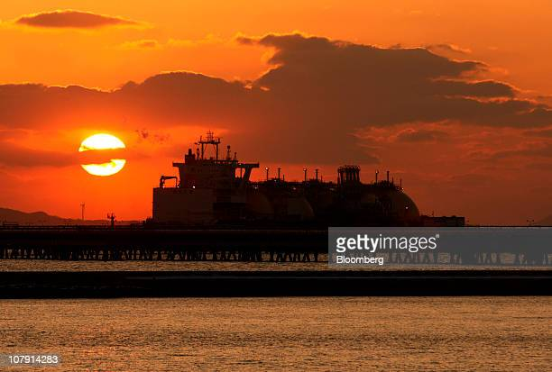The sun sets over a liquefied natural gas tanker at a port in Incheon South Korea on Thursday Jan 6 2011 Liquefied natural gas demand in Asia is...