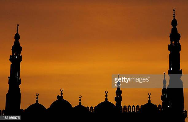 The sun sets over a mosque in the Egyptian capital Cairo late 05 July 2007 AFP PHOTO/KHALED DESOUKI