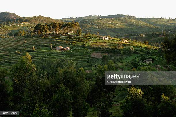 The sun sets over a rural community sitting among terraced hills about 70 kilometers south of the capital April 3 2014 in Nyanza Rwanda Rwanda will...