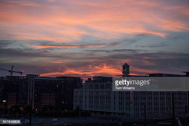 The sun sets over an iftar dinner on a roof deck in Northeast for guests who participated in fasting for Ramadan June 20 2016 Muslims and nonMuslims...