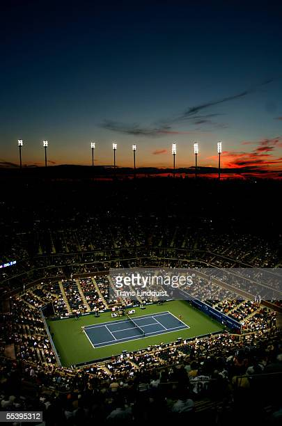 The sun sets over Arthur Ashe Stadium during the US Open at the USTA National Tennis Center in Flushing Meadows Corona Park on September 4 2005 in...