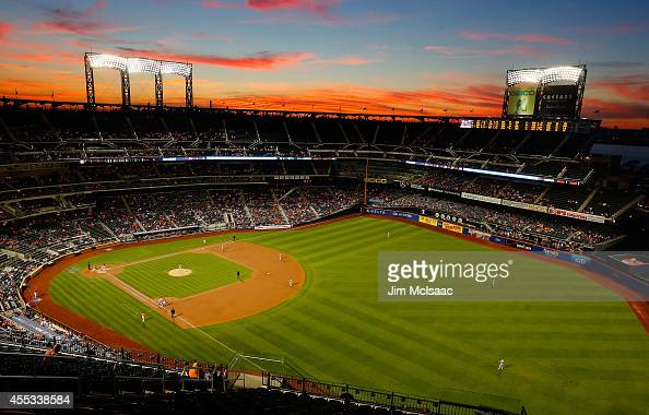 The sun sets over Citi Field during the first inning of a game between the New York Mets and the Washington Nationals on September 12 2014 in the...