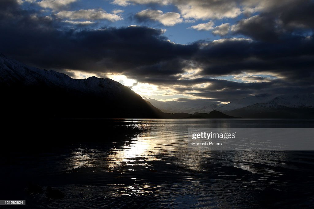 The sun sets over Lake Wanaka on August 17, 2011 in Wanaka, New Zealand.