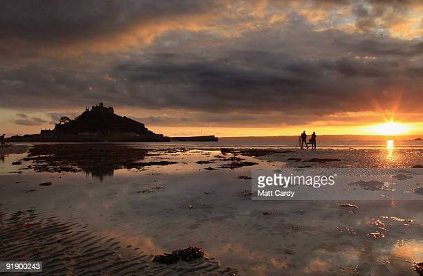 The sun sets over St Michael's Mount on October 14 2009 in Penzance England The tidal island which has houses shops a restaurant chapel and castle...