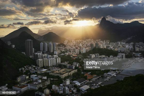 The sun sets over the city on February 23 2015 in Rio de Janeiro Brazil Rio marks its 450th anniversary on March 1 and is celebrating the event with...