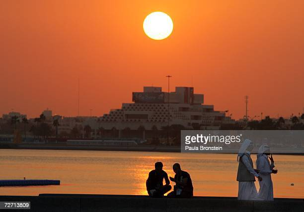 The sun sets over the Corniche in Doha during the 15th Asian Games Doha 2006 December 4 2006 in Doha Qatar The games feature 45 countries and regions...