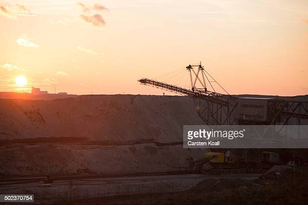 The sun sets over the CottbusNord openpit lignite coal mine during an event to mark the mine's closure on December 23 2015 near Cottbus Germany The...