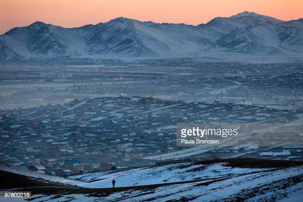 The sun sets over the hills as the cold takes over another night in the Ger district March 16 2010 in Ulaan Baatar Mongolia Many Mongolians have...