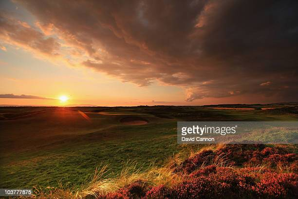 The sun sets over the island of Arran and the 15th green at The Prestwick Golf Club on August 26 2010 in Prestwick Ayrshire Scotland