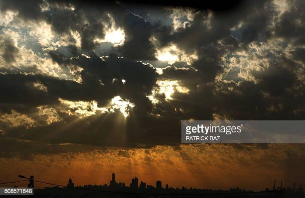 The sun sets over the Lebanese capital Beirut on February 5 2016 / AFP / Patrick BAZ