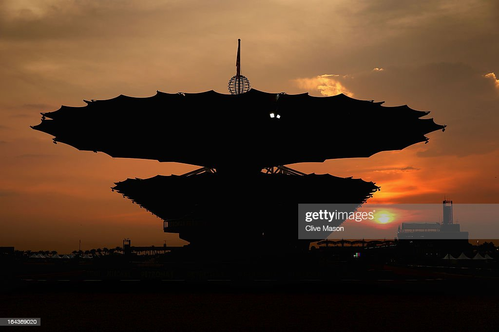 The sun sets over the main grandstand following qualifying for the Malaysian Formula One Grand Prix at the Sepang Circuit on March 23, 2013 in Kuala Lumpur, Malaysia.