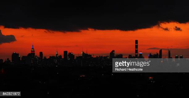 The sun sets over the Manhattan skyline as seen from Arthur Ashe Stadium on Day Seven of the 2017 US Open at the USTA Billie Jean King National...