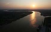 The sun sets over the Mississippi River with downtown in the background on August 24 2015 in New Orleans Louisiana The tenth anniversary of Hurricane...