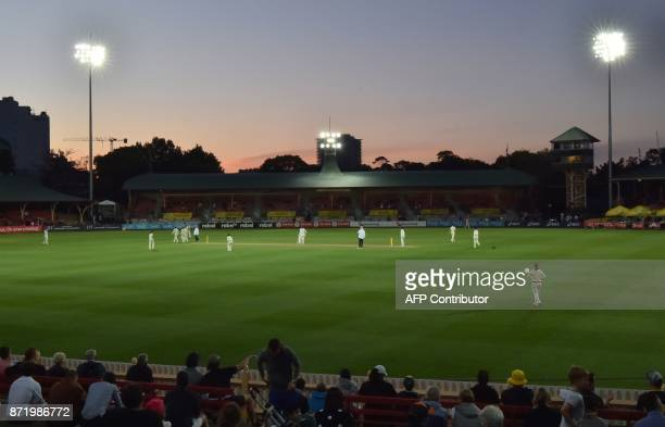 The sun sets over the North Sydney Oval during the first day of the women's Ashes cricket Test between Australia and England in Sydney on November 9...