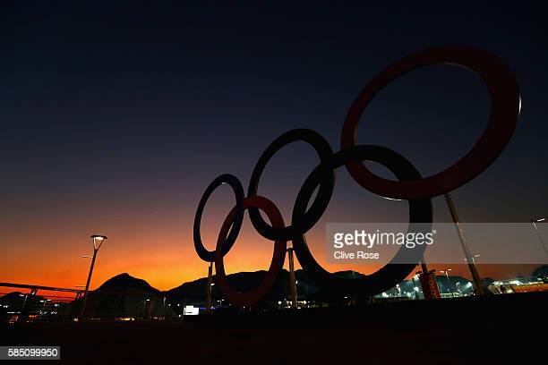 The sun sets over the Olympic Rings on the Olympic Park on August 1 2016 in Rio de Janeiro Brazil