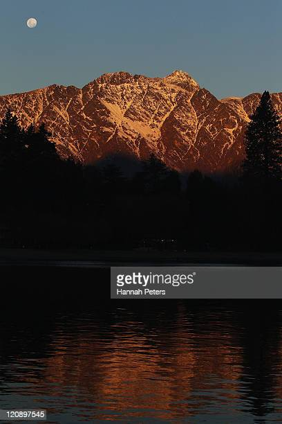 The sun sets over the Remarkables ahead of the Opening Ceremony for the Winter Games NZ at Earnslaw Park on August 12 2011 in Queenstown New Zealand