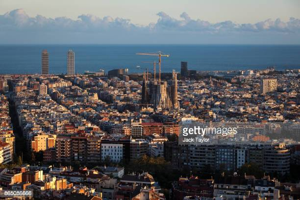 The sun sets over the Sagrada Familia on October 22 2017 in Barcelona Spain The Spanish government is to take steps to suspend Catalonia's autonomy...