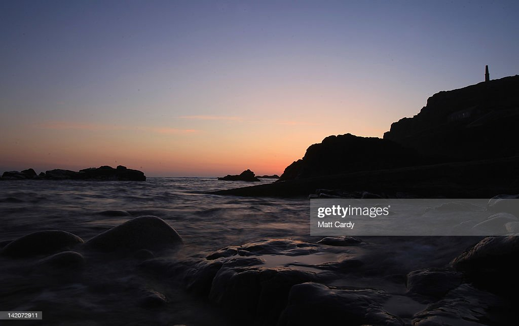 The sun sets over the sea at Cape Cornwall near St Just on March 29, 2012 in Cornwall, England. With only a few months to go until the opening ceremony of the London 2012 Olympic games, Britain's tourist industry is hoping to benefit from the influx of athletes, officials and visitors.