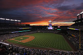 The sun sets over the stadium as the Milwaukee Brewers face the Colorado Rockies at Coors Field on July 14 2011 in Denver Colorado