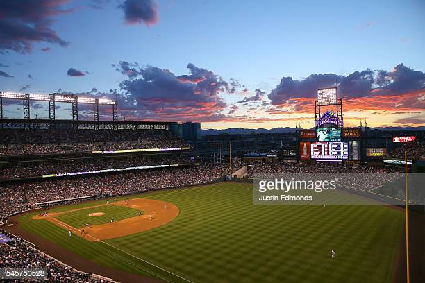 The sun sets over the stadium as the Philadelphia Phillies take on the Colorado Rockies at Coors Field on July 9 2016 in Denver Colorado