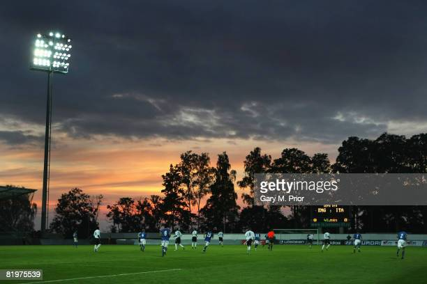 The sun sets over the Strelnice Stadium during the UEFA European U19 Championship Group B match between England and Italy at the Strelnice Stadium on...