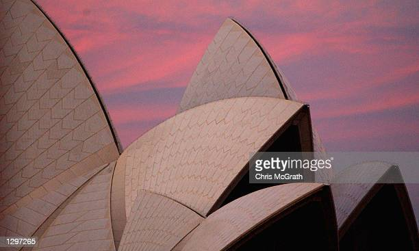 The sun sets over the Sydney Opera House on a winters afternoon in Sydney Australia on August 6 2002 The Opera House was designed by Danish architect...