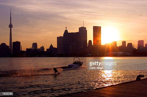 The sun sets over the Toronto skyline in his undated file photo The International Olympic Committee meets in Moscow July 13 2001 to decide between...