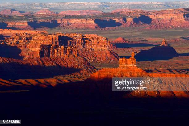 The sun sets over Valley of the Gods in Bears Ears National Monument seen from the Moki Dugway June 11 2017 north of Mexican Hat UT