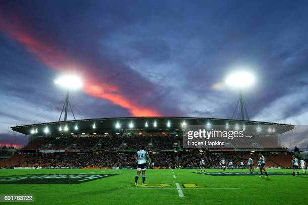 The sun sets over Waikato Stadium during the round 15 Super Rugby match between the Chiefs and the Waratahs at Waikato Stadium on June 3 2017 in...