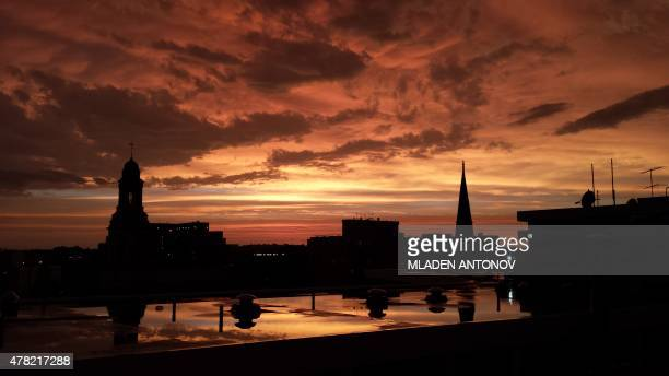 The sun sets over Washington DC after a heavy thunderstorm on June 23 2015 AFP PHOTO / MLADEN ANTONOV / AFP PHOTO / MLADEN ANTONOV