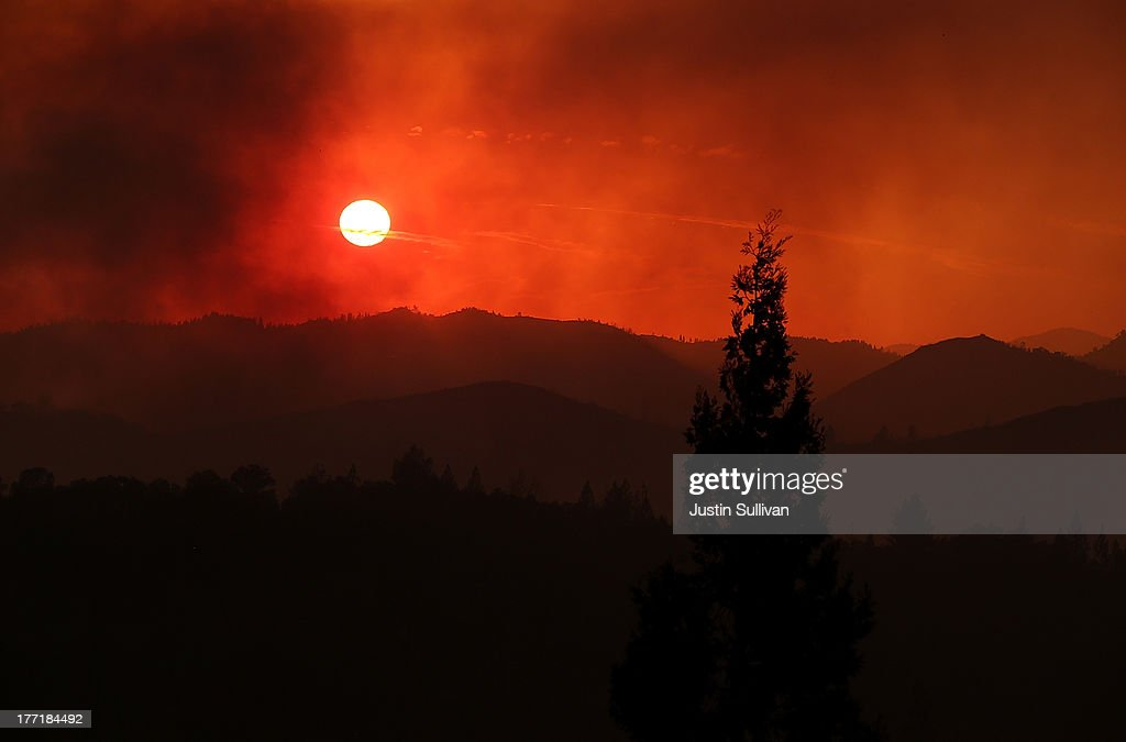 The sun sets through heavy smoke from the Rim Fire on August 21, 2013 in Groveland, California. The Rim Fire continues to burn out of control and threatens 2,500 homes outside of Yosemite National Park. Over 400 firefighters are battling the blaze that is only 5 percent contained.