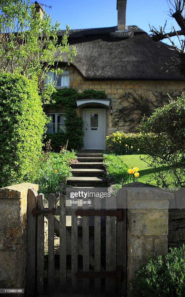 The sun shines on a thatched cottage in the Cotswold town of Chipping Campden on April 12 2011 in Gloucestershire England A popular tourist...