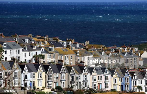 The sun shines on houses and buildings around the harbour of St Ives on March 4 2012 in Cornwall England With only a few months to go until the...