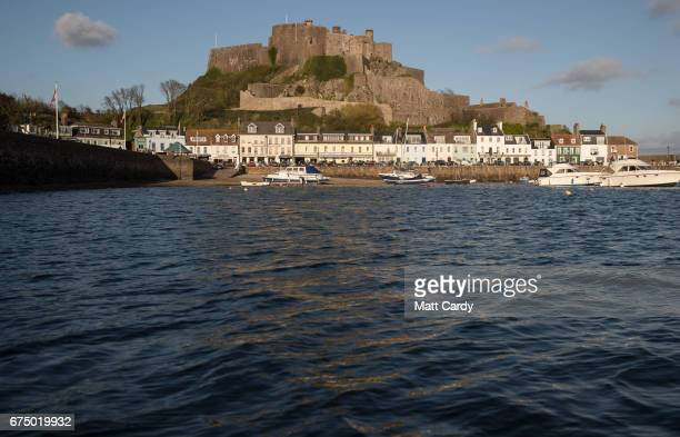 The sun shines on properties besides Gorey Harbour near St Helier on April 12 2017 in St Helier Jersey Jersey which is not a member of the European...