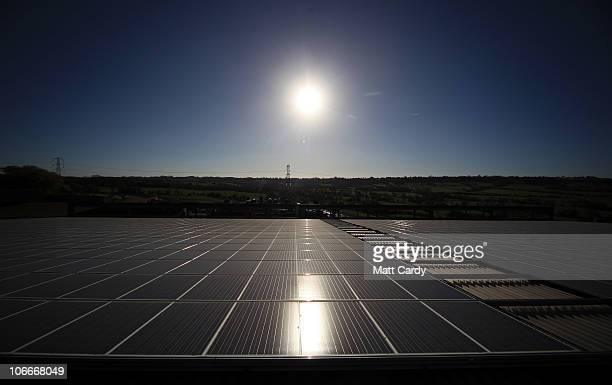 The sun shines on Worthy Farm's new solar photovoltaic system on November 10 2010 in Glastonbury England The system installed on the roof of the cow...