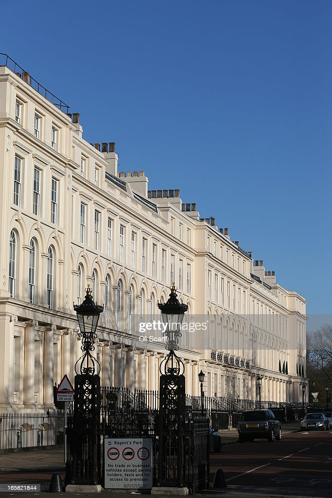 The sun shines over a terrace of residential properties in an affluent area of London adjacent to Regents Park on April 6, 2013 in London, England. Recent research has indicated that average monthly rents in central London have exceeded 5,000 GBP.