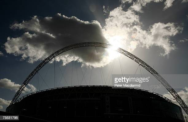 The sun shines through the Wembley Stadium arch on March 9 2007 in London England The Football Association is expected to receive the keys to the...
