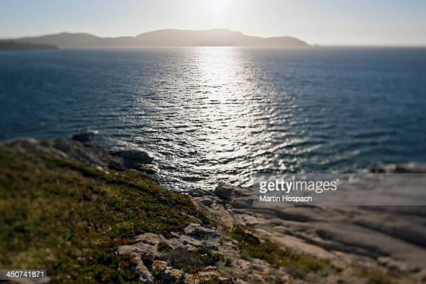 The sun shining on the Mediterranean Sea, Calvi, Corsica, France