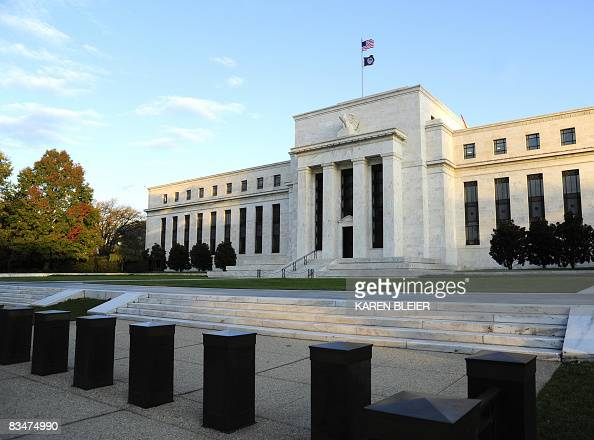 The sun splashes light on the Federal Reserve Building early October 29 2008 in Washington DC The US Federal Reserve was widely expected to deliver...