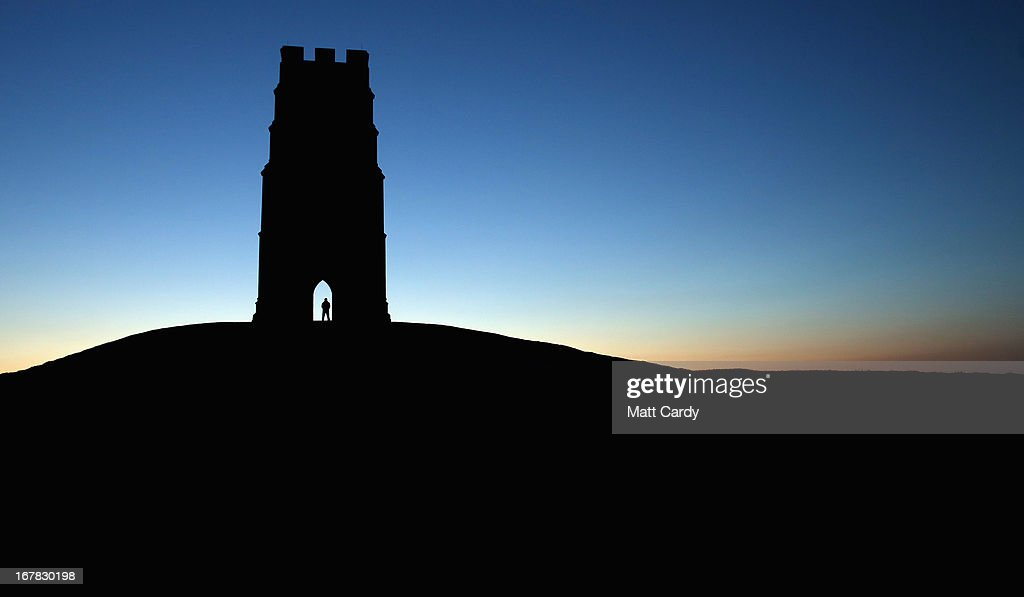 The sun starts to rise as people begin to gather for a Beltane dawn celebration service in front of St. Michael's Tower on Glastonbury Tor on May 1, 2013 in Glastonbury, England. Although more synonymous with International Workers' Day, or Labour Day, May Day or Beltane is celebrated by druids and pagans as the beginning of summer and the chance to celebrate the coming of the season of warmth and light. Other traditional English May Day rites and celebrations include Morris dancing and the crowning of a May Queen with celebrations involving a Maypole.