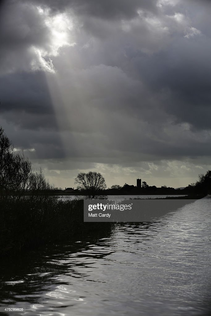 The sun tries to break through rain clouds gathered over the flood stricken village of Muchelney which, as of today, has been cut off by flood water for eight weeks, on the Somerset Levels on February 27, 2014 in Somerset, England. According to the Met Office, England and Wales have experienced their wettest winter since records began in 1766, with parts of flood-hit southern England having experienced 83% more rain than average.