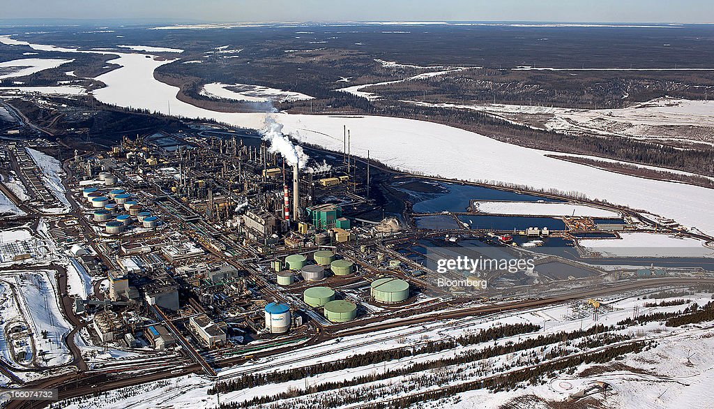 The Suncor Energy Inc. base plant is seen in this aerial photograph of the Athabasca Oil Sands near Fort McMurray, Alberta, Canada, on Tuesday, March 26, 2013. Canadian light oil prices retreated from a six-month high on the spot market reached last week as production slipped and refineries prepared for maintenance. Photographer: Brett Gundlock/Bloomberg via Getty Images