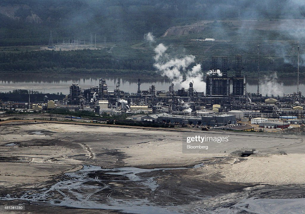 The Suncor Energy Inc base plant stands in this aerial photograph taken above the Athabasca Oil Sands near Fort McMurray Alberta Canada on Wednesday...