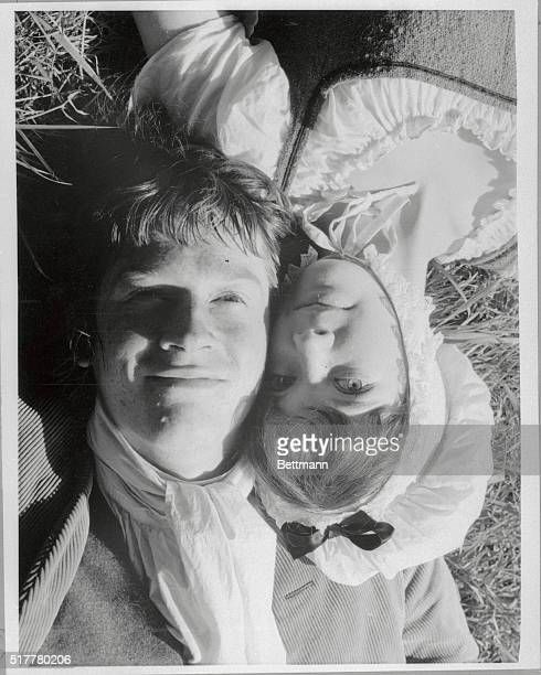 The sunlight catches John Hurt and Pamela Franklin the youthful romantic leads in the movie Sinful Davey as they lie on the grass in Scotland Hurt...