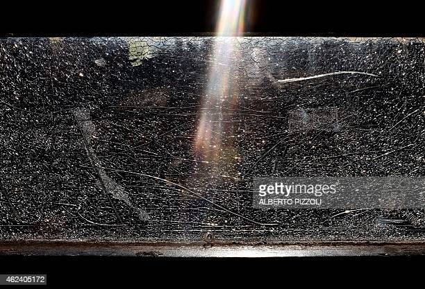 The sunlight shines on a plexiglass fence near the ruins of Largo Argentina on January 28 2015 in Rome AFP PHOTO / ALBERTO PIZZOLI