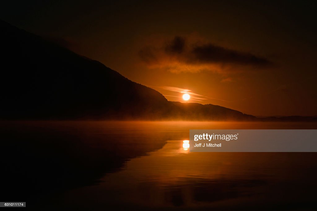 The sunrises at Tarbet Loch Lomond on January 5, 2017 in Loch Lomond, Scotland. As a cold snap sets in the Met Office has issued a yellow be aware warning, with temperatures plunging to -6C in some places and health officials warning of increased danger to the elderly and vulnerable.