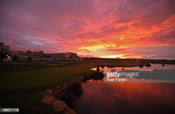 The sunrises over the 18th green before the continuation of the weather delayed first round of the Portugal Masters at Oceanico Victoria Golf Club on...