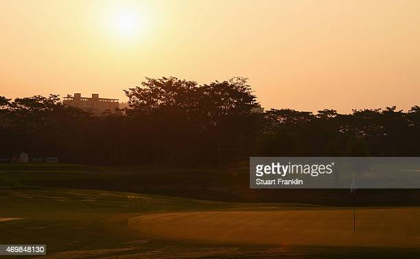 The sunrises over the third hole during the first round of the Shenzhen International at Genzon Golf Club on April 16 2015 in Shenzhen China
