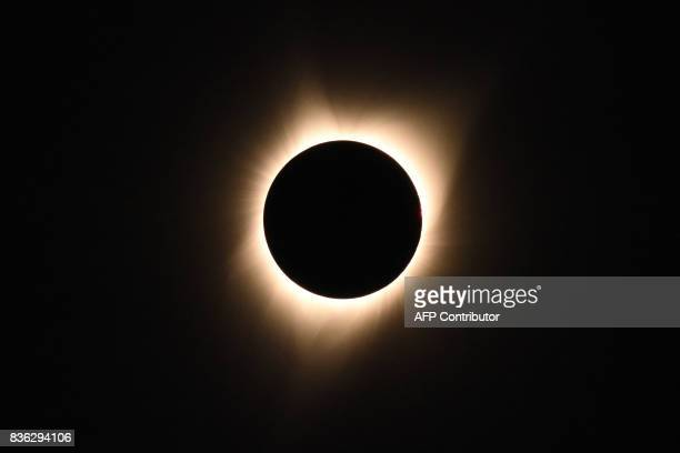 The sun's corona is visible as the moon passes in front of the sun during a total solar eclipse at Big Summit Prairie ranch in Oregon's Ochoco...